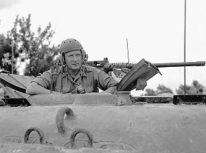 """Bert Hoffmeister - Major-General B.M. Hoffmeister, General Officer Commanding 5th Canadian Armoured Division, in the turret of the Sherman tank """"Vancouver"""" near Castrocielo,  23 May 1944"""
