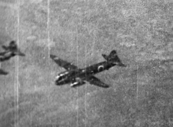 "An Australian gun camera photograph of two Japanese Mitsubishi G4M2 ""Betty"" medium bombers during a raid on Darwin in June 1943. Betty bomber Darwin (AWM P02822-001).jpg"