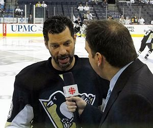 Hockey Night in Canada - Bill Guerin of the Pittsburgh Penguins (left) is interviewed by HNIC reporter Elliotte Friedman before a May 8, 2010 playoff game against the Montreal Canadiens at Mellon Arena