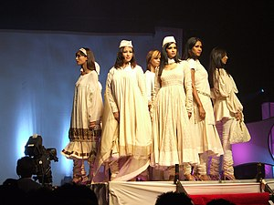"Fashion in India - Post-independence focus on revival of traditional textile and design led to the rise of ""ethnic chic""."