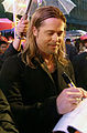 Brad Pitt signing autographs in Seoul (cropped).jpg