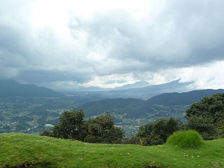 Guatemalan Highlands upland region in southern Guatemala, lying between the Sierra Madre de Chiapas to the south and the Petén lowlands to the north; made up of a series of high valleys enclosed by mountains