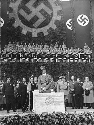 Volkswagen Group - May 26, 1938: Laying the foundation stone of the first Volkswagen plant by Adolf Hitler. In the front right is Ferdinand Porsche.