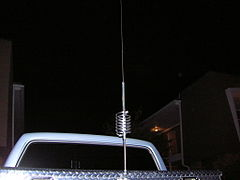 CB antenna with loading coil, mounted on pickup-truck metal tool box