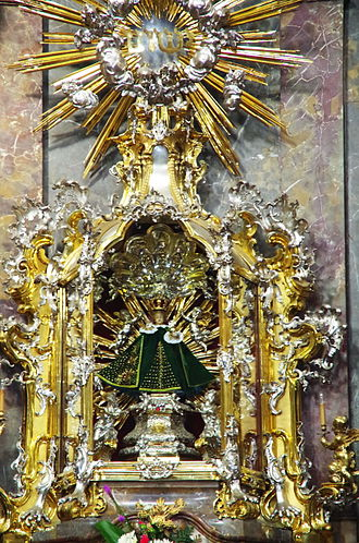 Infant Jesus of Prague - The image wearing its ordinary green vestment along with its present canonical crown.