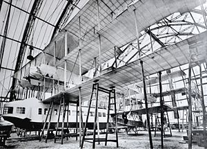 Caproni Ca.60 - The Transaereo under construction in Sesto Calende. Gianni Caproni is sitting on the left side outrigger.