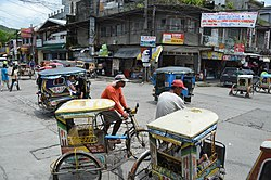 Rickshaws along a street in Catbalogan