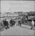 Centerville, California. Members of farm family board evacuation buses. Evacuees of Japanese ances . . . - NARA - 537585.tif