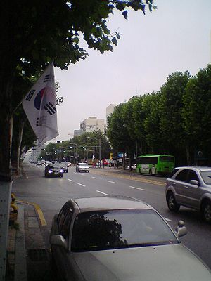 Constitution Day (South Korea) - Street along a road in Seoul during Constitution Day. Flags are hung up along street lights during this day.