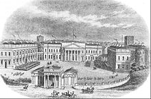 An elevated view of four neoclassical buildings, the main block, two side blocks and a gateway