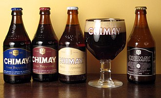 Chimay Brewery - The four varieties of Chimay, with Chimay Blue in the glass.