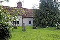 Church of Ss Mary & Lawrence - churchyard south with cottages.JPG