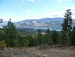 Colville National Forest with a lake and mountains.