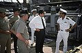 Commander T.L. Kaye, commanding officer of the ocean minesweeper USS CONQUEST (MSO 488), explains minesweeping equipment to William Ball III, secretary of the Navy. Ball is meeting - DPLA - 810ba3726bdfb85f56c24636445747d5.jpeg