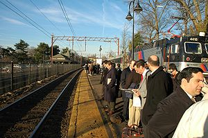 Commuter town - Many municipalities in New Jersey can be considered commuter towns. Here, riders wait in Maplewood for a train bound for New York City during the morning rush hour.