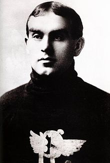 Profile photo of a young man wearing a sweater with a logo on his chest