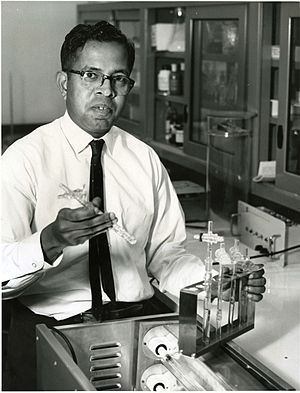 Cyril Ponnamperuma - Cyril Ponnamperuma (1923-1994) of the Exobiology Division at NASA's Ames Research Center points out the simple laboratory equipment with which he artificially produced ATP, the source of energy for all forms of life. 1963 photo.