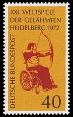 A postage stamp featuring a red image of an archer with drawn bow sat in a wheelchair, on a yellow background