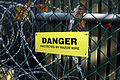 Danger - Protected By Razor Wire (2954535776).jpg