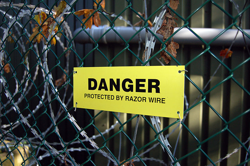 File:Danger - Protected By Razor Wire (2954535776).jpg
