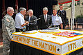 Defense.gov News Photo 100614-D-9880W-111 - Secretary of Defense Robert M. Gates helps wield the sword at the ceremonial cake-cutting in the Pentagon to mark the 235th birthday of the United.jpg