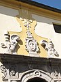 Dettaglio portone di ingresso chiesa S. Antonio abate.jpg