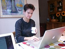 Diane Coyle at work with Apple laptop-9Oct2009.jpg