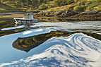 Distorting water reflections at Digermulen port, Hinnøya, Norway, 2015 September.jpg