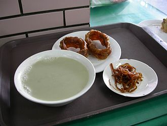 Beijing cuisine - A bowl of douzhi (left) with breakfast items