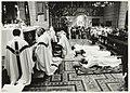 Drie priesters, Nico van der Peet, broeder Piet Lindner en Han Snel liggen plat op de grond tijdens hun wijding in de St. Bavo Kathedraal. NL-HlmNHA 54031903.JPG