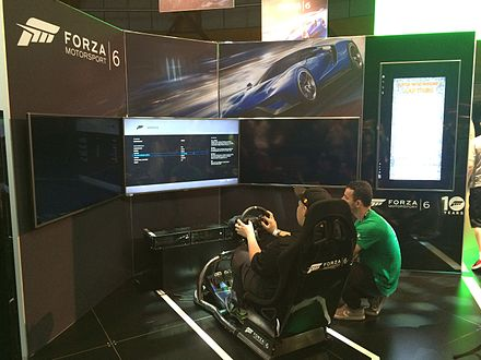 A race of Forza Motorsport 6 , utilizing a racing wheel controller, at the EB Games Expo 2015. EB Games Expo 2015 - Forza Motorsport 6.JPG