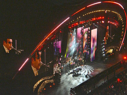 Elton John on piano at the Concert for Diana, commemorating the 10 year passing of Princess Diana, at Wembley Stadium on 1 July 2007 EltonJohnDianaConcert.JPG