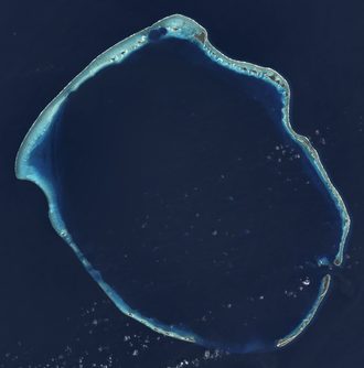 Enewetak Atoll - Landsat 8 satellite image of Enewetak Atoll. The crater formed by the Ivy Mike nuclear test can be seen near the north cape of the atoll, with the smaller Castle Nectar crater adjoining it.