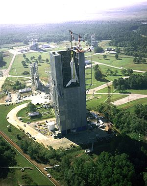 Space Shuttle Enterprise - A crane hoists Enterprise into the Dynamic Structural Test Facility to undergo dynamic testing in launch configuration.