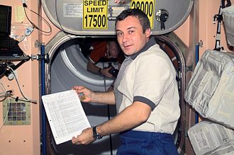 Expedition 3 - Vladimir N. Dezhurov, Expedition Three flight engineer in Node 1 on the International Space Station. (Note the speed limit signs on the hatch)