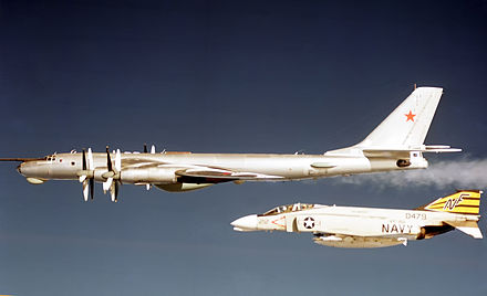 United States Navy F-4 Phantom II shadows a Soviet Tu-95 Bear D aircraft in the early 1970s F-4B VF-151 CV-41 TU-95.jpg