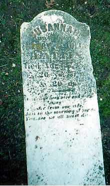 Fallen gravestone of Susannah Lattin (1848-1868) in Powell Cemetery in 2002.jpg