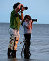 Father And Daughter Take Sunset Pictures Of Old Pier By Carole Robertson.jpg