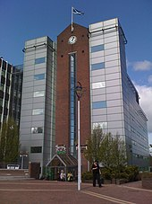 Glenrothes wikivisually six storey office building with facing brick glass and silver cladding with clock feature malvernweather Image collections