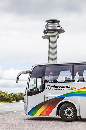 Flygbussarna - Flygbuss by the control tower of Stockholm Arlanda Airport.