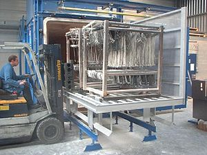 English: Pyrolysis oven with coating hooks. Th...