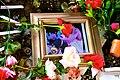 Framed Photo of Derrick Rose Clutching Leg Rose at Pray 4 Rose Shrine (16752067296).jpg