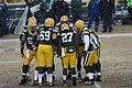 GB offense huddle at start of game Dec 2013.jpg