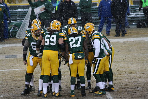 GB offense huddle at start of game Dec 2013