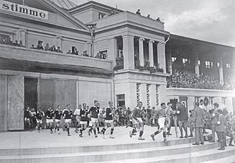 Finnish Workers' Sports Federation football team - The German and Finnish teams entering the field in the 1925 Workers' Olympiad final in Frankfurt