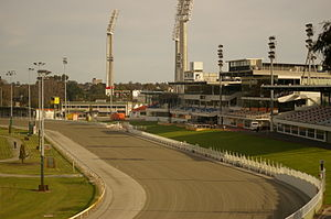 Gloucester Park - Grandstands, track and finish line. The floodlights surrounding the WACA Ground are visible in the background