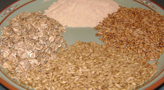 Gluten - Examples of sources of gluten (clockwise from top): wheat as flour, spelt, barley, and rhy as rolled flakes