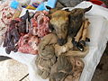 Goat tripe and heads at Peru market.jpg