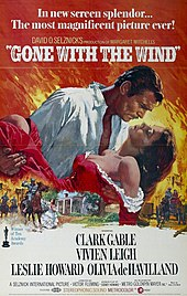 Poster shows Rhett Butler carrying Scarlett O'Hara against a backdrop of the Burning of Atlanta
