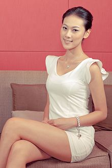 Gorgeous Chinese model sitting on a sofa (6759436597).jpg